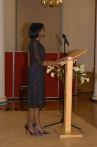 Angela delivering a speech at a book launch